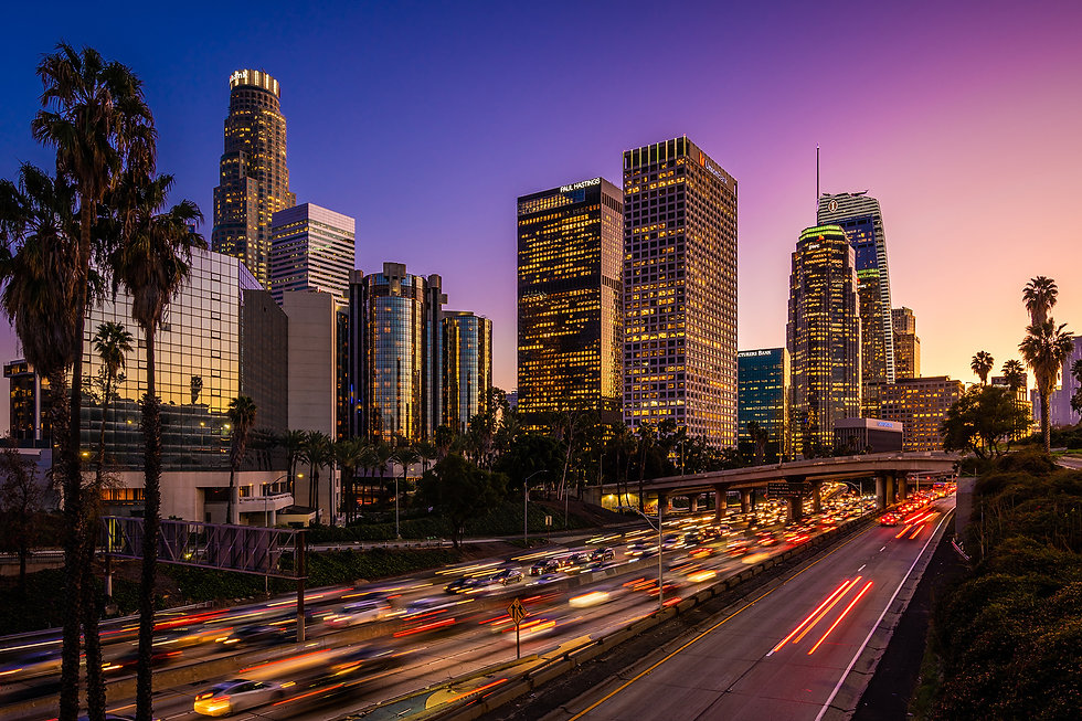 skyscrapers of downtown los angeles and surrounding freeways at sunset. consilium experiential marketing agency.