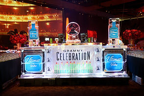 an ice bar at the grammys with grammys logo and vodka sponsor logo set in ice. consilium.