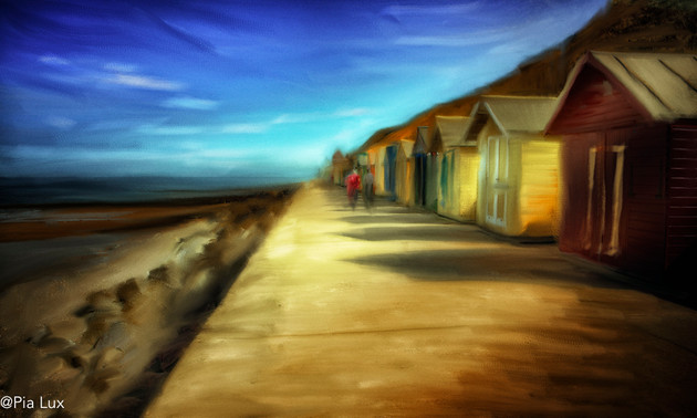 Colourful huts by the sea