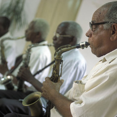 a Salsa Music Band on the Parce Cespedes in the city of Santiago de Cuba on Cuba in the Ca