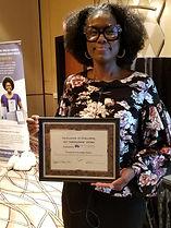 Joy holding award.jpg