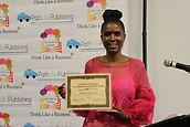 Joy holding Freelancers Union award.JPG