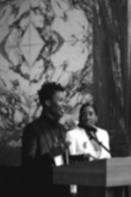 Moses speaking Pamela in foreground.jpg