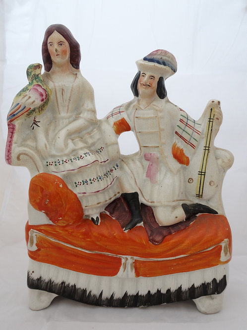 Staffordshire Figurine Musician & Companion on Daybed