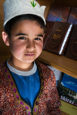 Afghan refugee working in teahouse, Shiraz