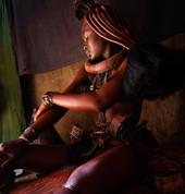 Himba applying ocre, Namibia