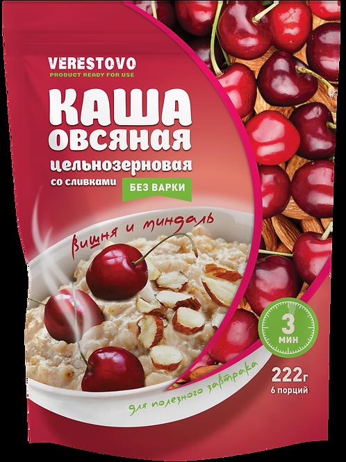 Oatmeal porridge with cherries, almonds and cream