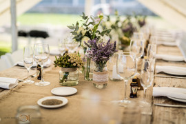 Blue Bay Lodge, Saldanha Bay, Small intimate tented reception with lanterns, fairy lights and spectacular decorating. Table set with beautiful flowers and long shiny glasses.