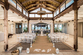 Blue Bay Lodge, Saldanha Bay inside reception area with tall airy roof and white chairs.