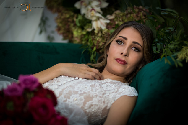 Web & EBeautiful bride in her wedding dress on her wedding day showing off her phenomenal bouquet while sitting on a couch in the forest of the well-known Lourensford Wine Estate, Somerset West, Cape Town. Edited with Brown Autumn colours.-Mail Ready-1045.jpg