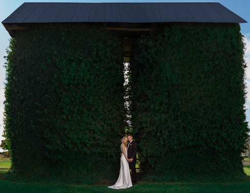Bridal couple in front of the old Silos on the beautiful Loch Lynne Estate outside Durbanville, Cape Town.