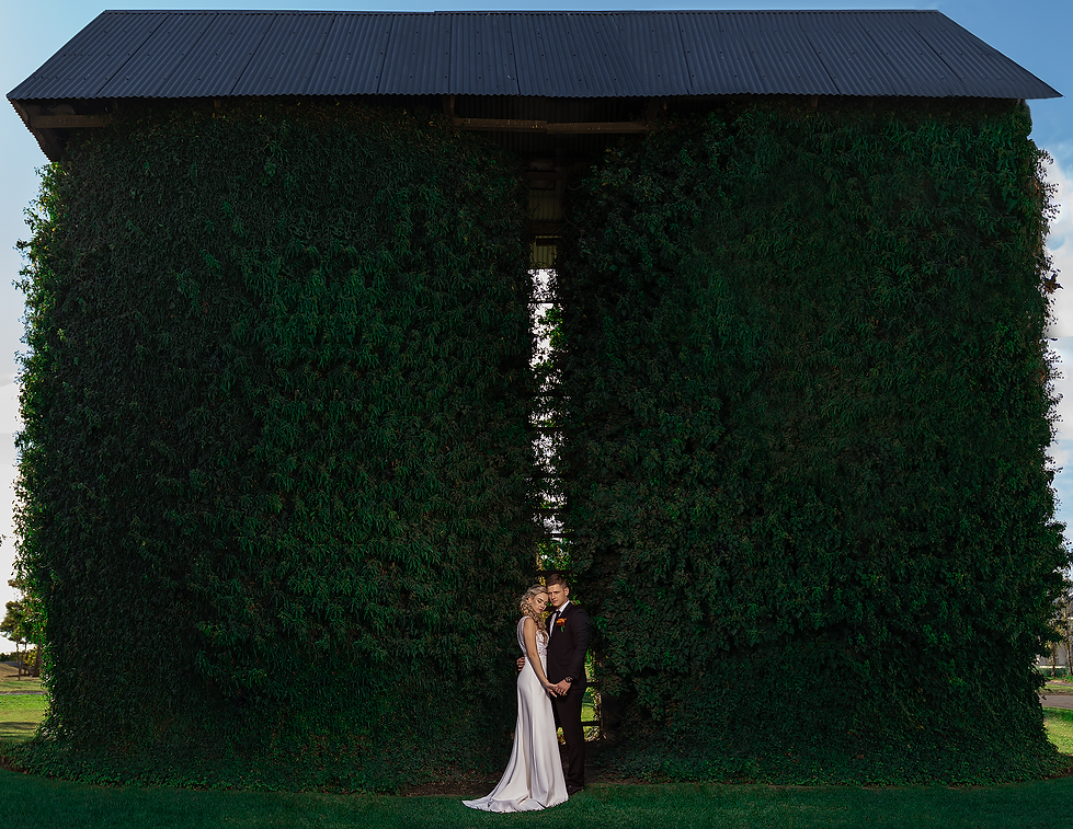 Bride and Groom in front of the old Silos on the beautiful Loch Lynne Estate outside Durbanvill, Cape Town