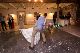 Blue Bay Lodge, Saldanha Bay, Small intimate tented reception with lanterns and fairy lights and a dance floor in the main building. Here is the bridal couple with their first dance.