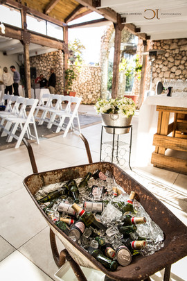 Blue Bay Lodge, Saldanha Bay inside reception area with tall airy roof and white chairs and rose petals on the floor.