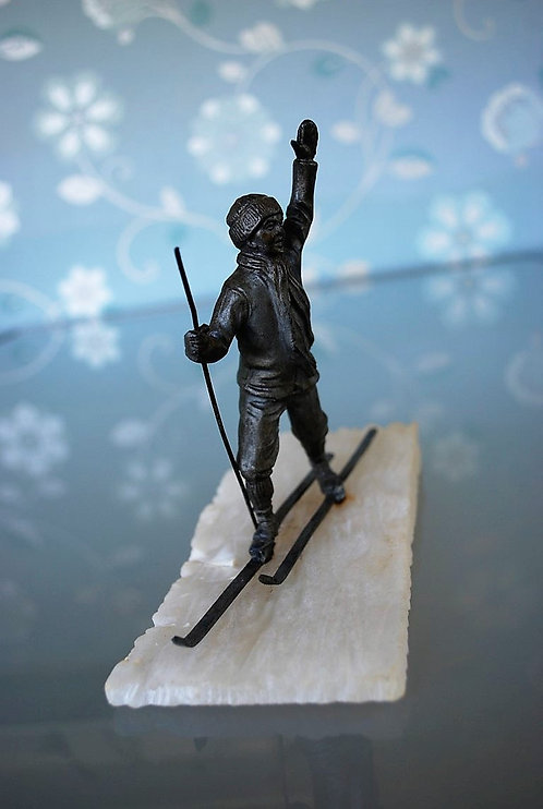 Cross-country skier on alabaster base. 1950s
