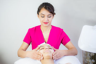 beautician giving a facial to client