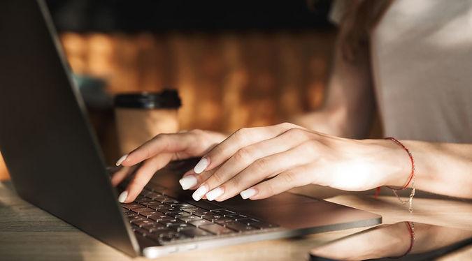 Woman-Typing-Coding-Laptop-Outside-e1572