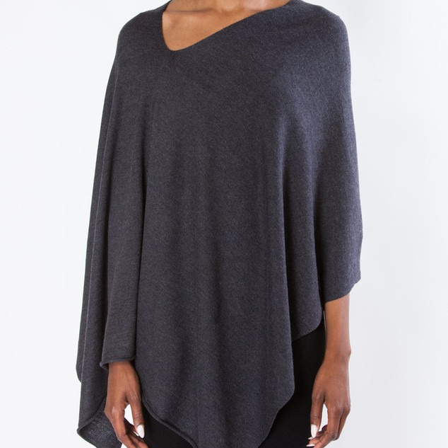 Multi-positionable '8 ways to wear' poncho wrap. Charcoal available in store now.