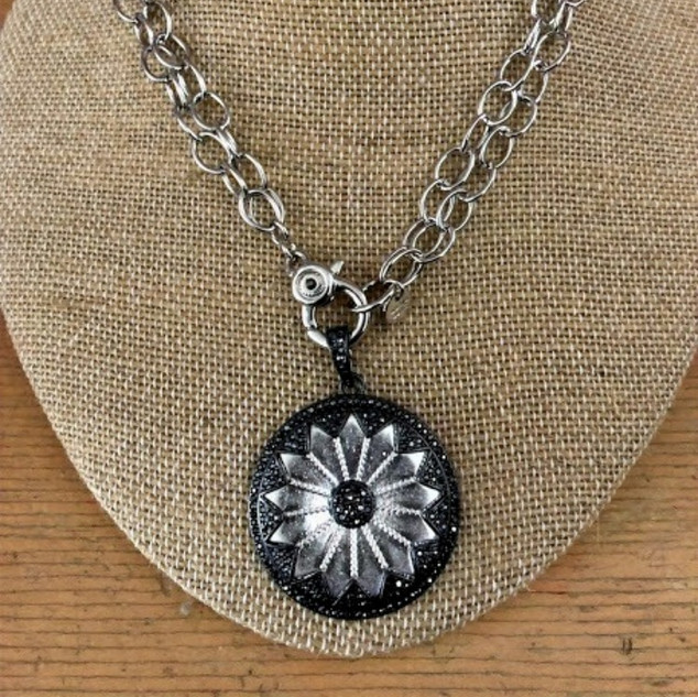 Shiny metal chain necklace with pave sunflower disc design.