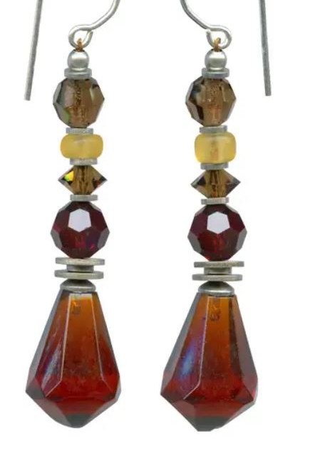 Dark topaz glass drops. Accents in garnet and smoke topaz are Austrian crystal. Frosted light amber Czech glass. Sterling silver ear wires.