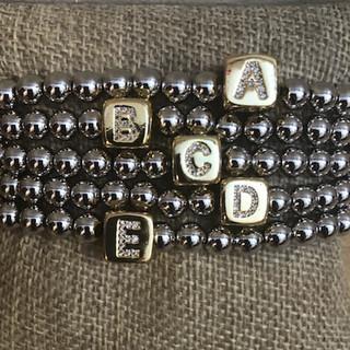 Stretch initial bracelets