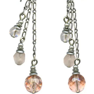 Coral tone earrings with Czech glass beads. Sterling silver ear wires.