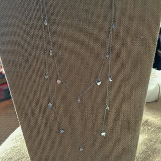 Sterling silver charm necklace with adjustable closure