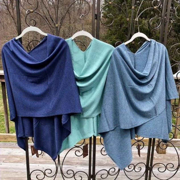 Multi-positionable '8 ways to wear' poncho wrap. Limited colors available.