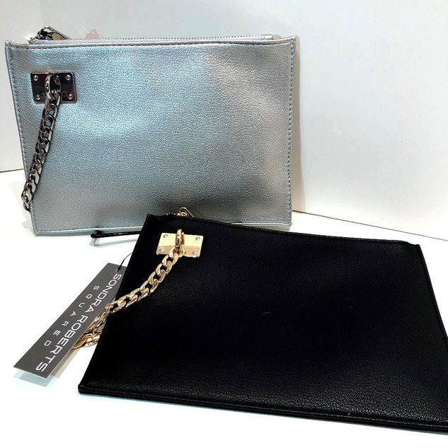 Faux leather wristlet with chain strap