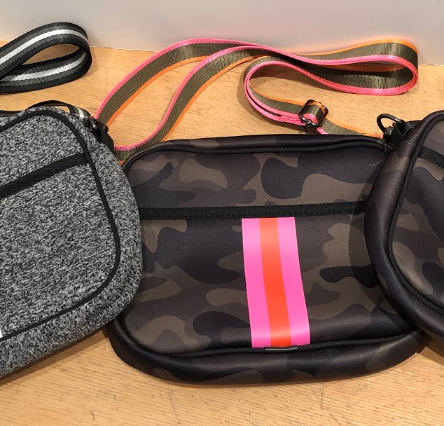 Neoprene crossbody bags with adjustable strap.