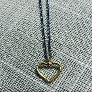 Gold heart on oxidized sterling silver chain