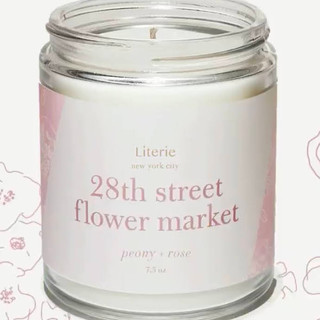 Candle has notes of peony and rose. Made of a soy and coconut wax blend and paired with high-quality fragrance oils.