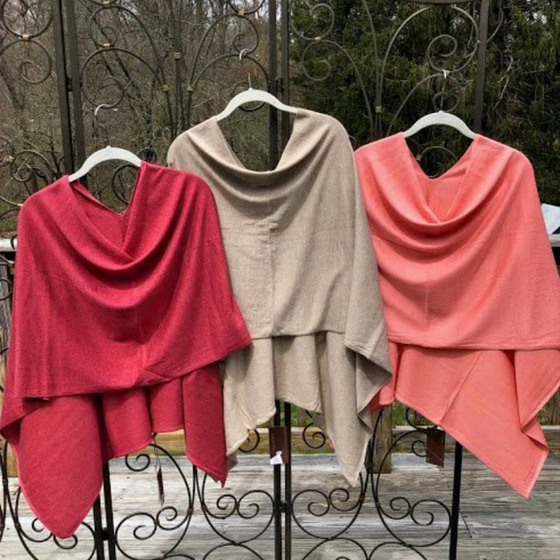 Multi-positionable '8 ways to wear' poncho wrap.