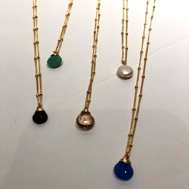 Gold vermeil necklaces with semi-precious stones.