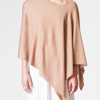 Multi-positionable '8 ways to wear' poncho wrap. Camel color coming soon.