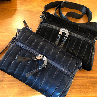 Crossbody bags with zipper closure. Only black available.