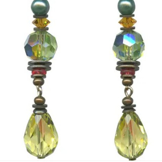 Faceted pastel jonquil yellow Austrian crystal drops. Czech glass and Austrian crystal accents in peridot, rose pink and topaz. Silver coated glass pearl accents. Sterling silver ear wires.