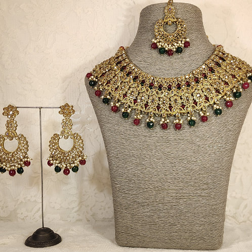 Large collar - faux pearl with red and green beading.