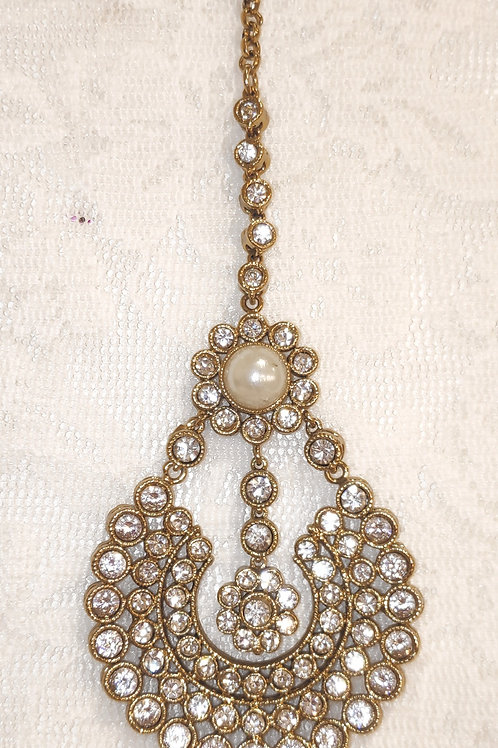 Antic tikka with white stones and pearl