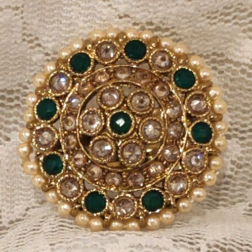 Antic ring round green and ad stone studded