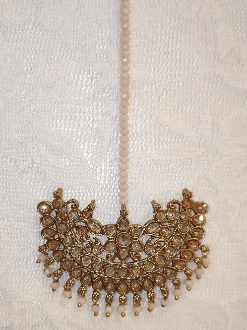 Antic tikka with gold ad stones and pink beads