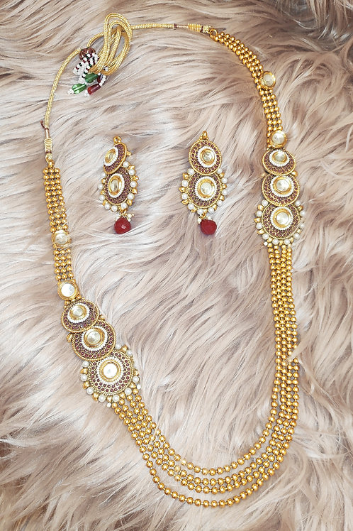 Antic long necklace with delicate fuschia stone work