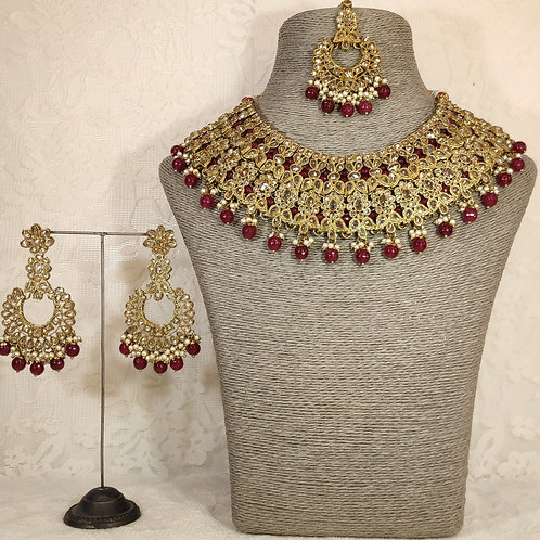 Large collar - faux pearl and maroon beading.