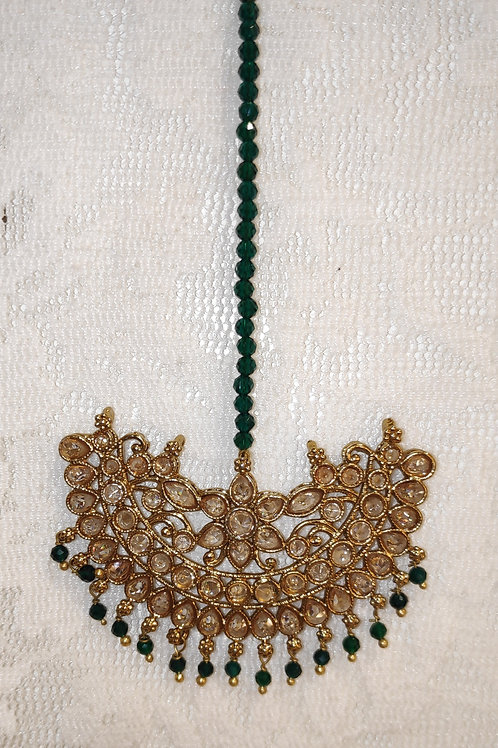 Antic tikka with gold ad stones and bottle green beads