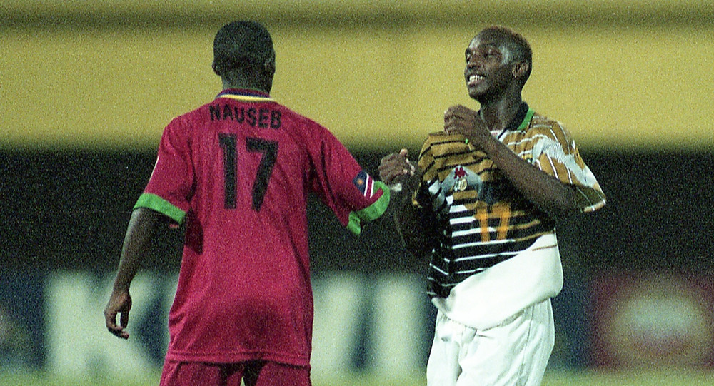 Namibia's Robert Nauseb congratulates Benni McCarthy after his four goals - BackPagePix