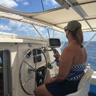 Taking a turn at the helm