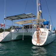 Showering off the back of the Catamaran