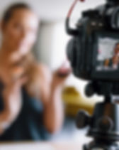 young-female-vlogger-recording-a-make-up
