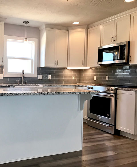 Bright kitchen with stainless steel appliances and white cabinetry