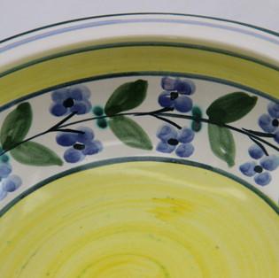 Muster Fayence gelb mit blauen Blumen